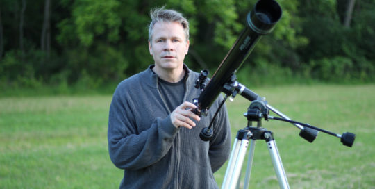 "Brad Peterson with telescope on location during ""what the open heart allows"" music video film-shoot"
