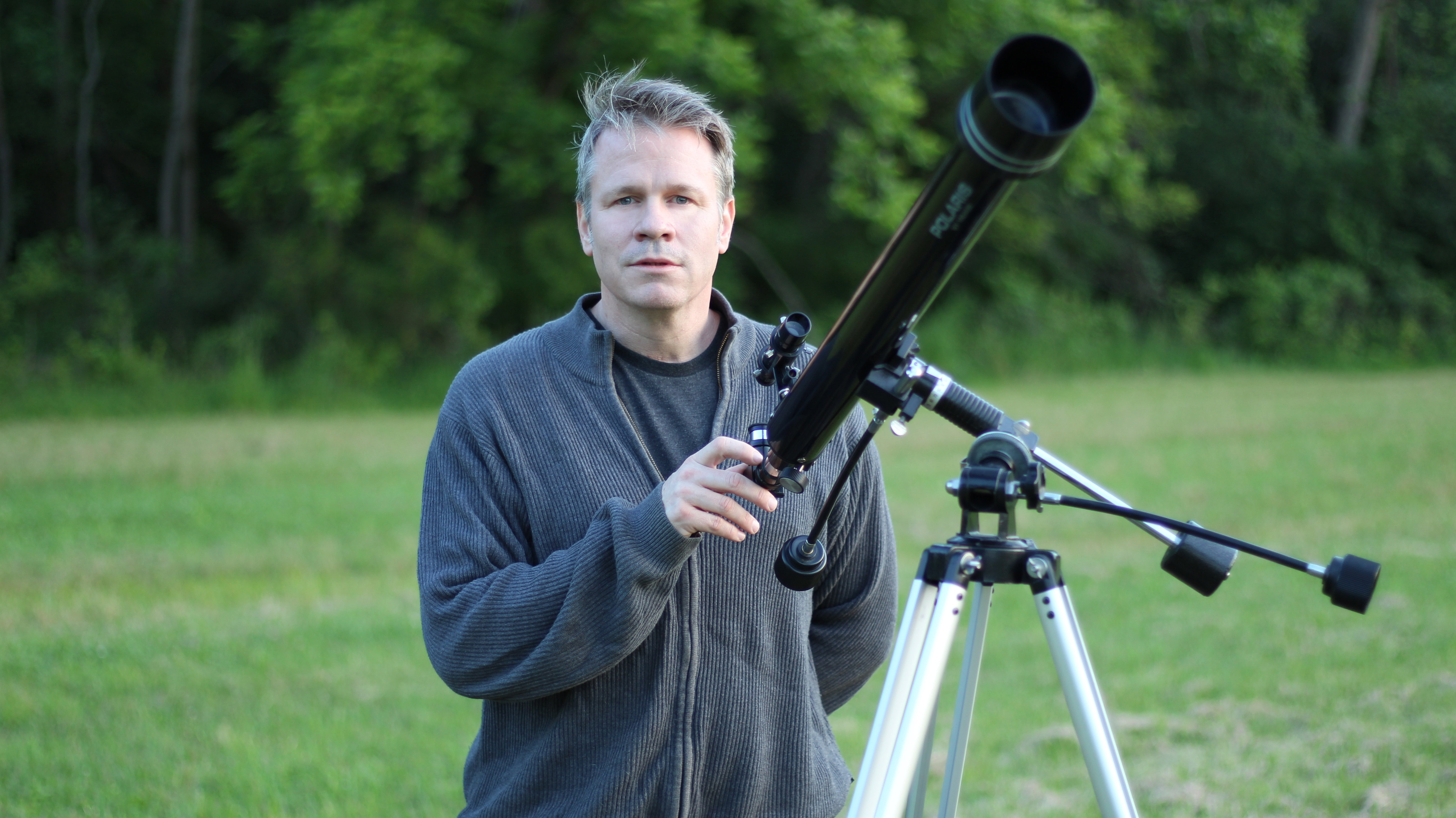 """Brad Peterson with telescope on location during """"what the open heart allows"""" music video film-shoot"""