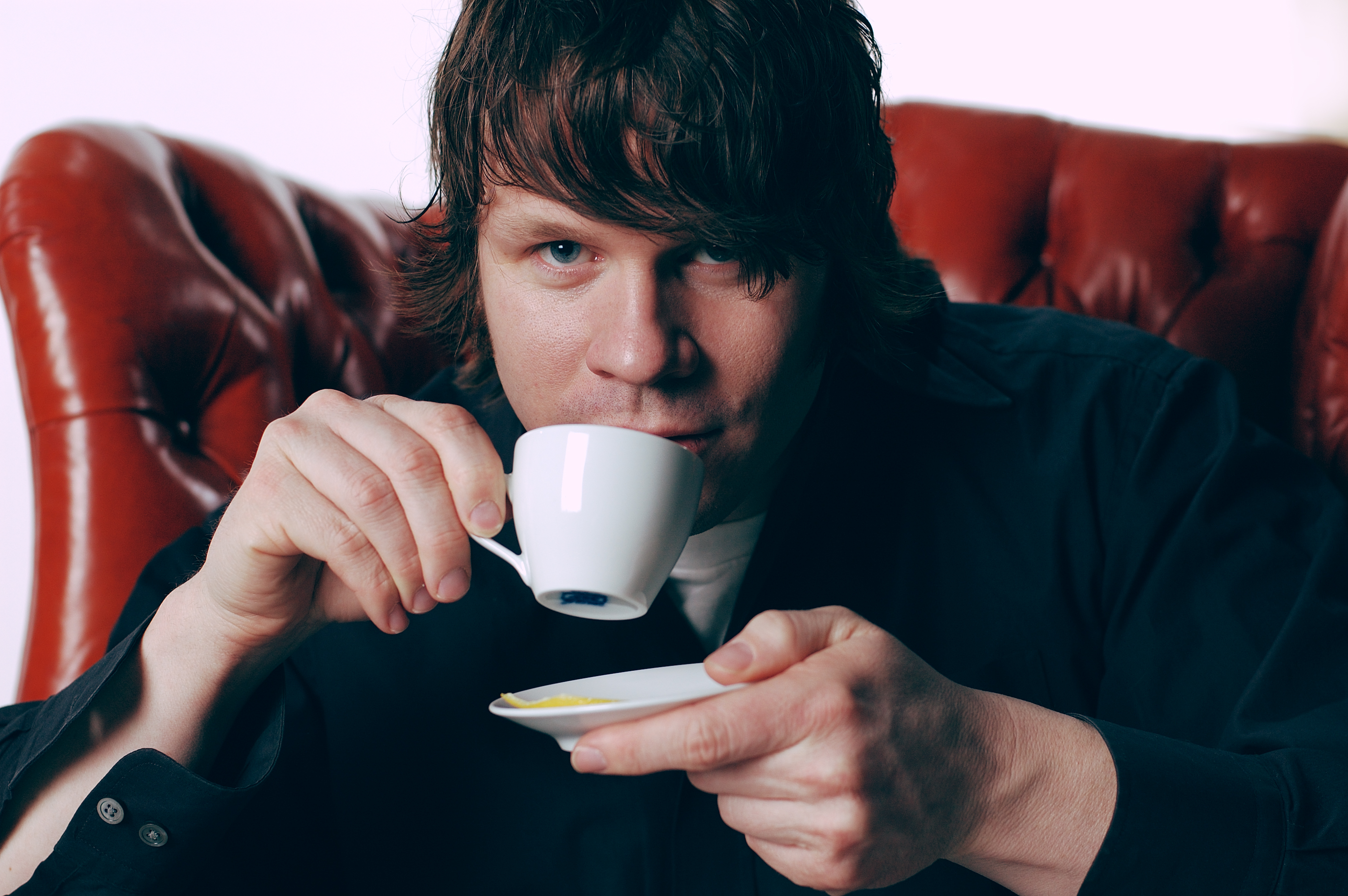 Brad Peterson drinking coffee during a music video film-shoot